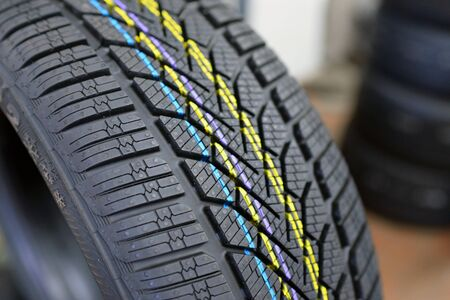 profile of a new car tyre in a car repair shop Reklamní fotografie