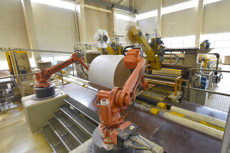 Paper mill: production of paper rolls for the printing industry - paper rolls in a factory Redakční
