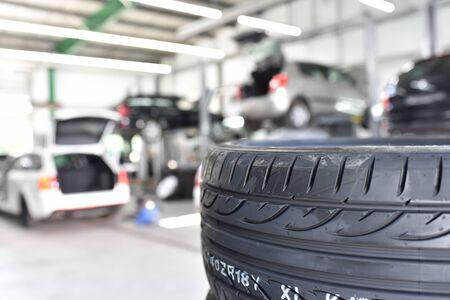 profil of car tyre in the car repair workshop - closeup