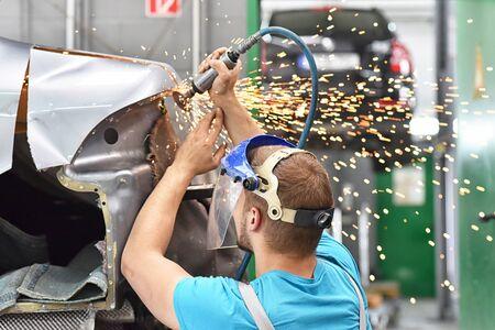 repair car body by a mechanics in the workshop