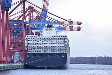 transport and logistics by water - loading of ships in a port with goods for export
