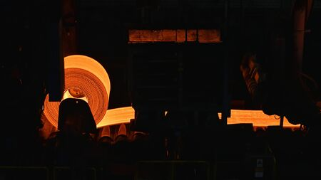 glowing roller metal in a steel mill - industrial factory for the production of sheet metal