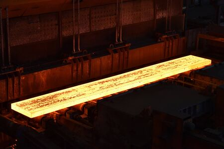glowing brame in a steel mill - industrial factory for the production of metal sheets