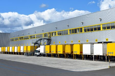 modern industrial buildings in transport - loading of goods on trucks of a forwarding agency for export