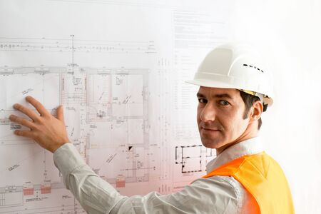 Architect planning a house on the ground plan