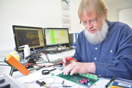engineer at the workplace - assembly and development of electronics in a modern factory