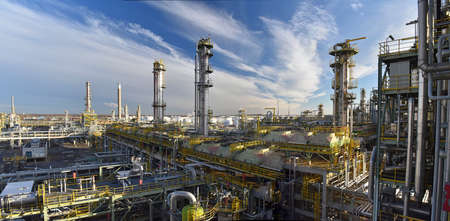 pipeline, storage tanks and buildings of a refinery - industrial plant for fuel production