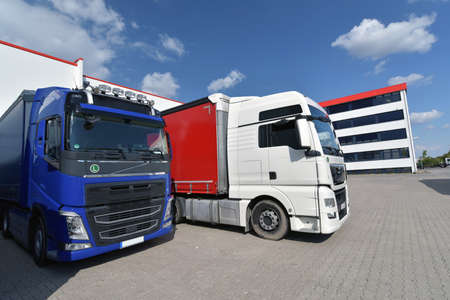 Trucks loading at a depot of a forwarding agency - Transport and logistics in goods trade