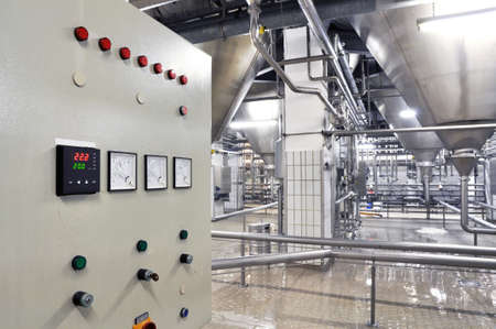 Industrial plant in a modern brewery - technology in a factory building with pipes and fittings