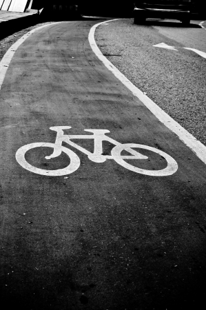bicycle wheel: Monochrome bicycle road sign Stock Photo