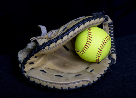 Softball Mitt With Yellow Ball Stock Photo