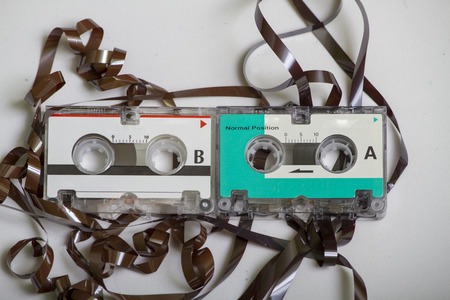 audio cassette: Retro  Vintage Two Micro Cassettes Eaten With A Recorder Stock Photo