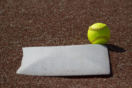 homeplate: A Yellow Fastpitch Softball In Fair Territory Over 3rd Base Stock Photo