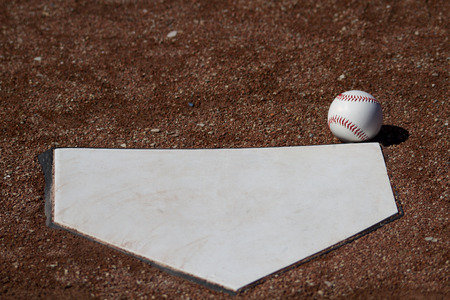 White Baseball In Fair Territory In Front Of Homeplate Stock Photo