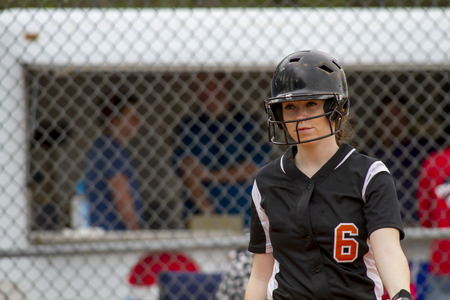 fastpitch: A Female Fastpitch Softball Player Entering The Batters Box