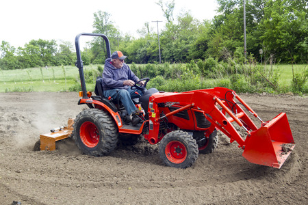 Stirring Up Dust In The Garden With A Compact Tractor