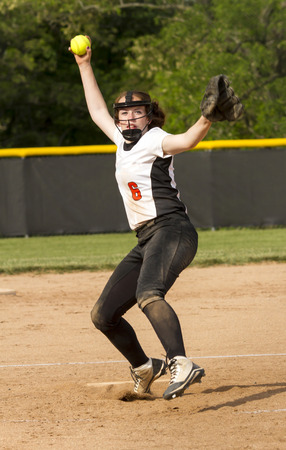 A high school fastpitch softball pitcher bringing the heat.
