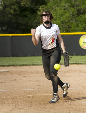 fastpitch: A fastpitch softball pitcher during a high school game.