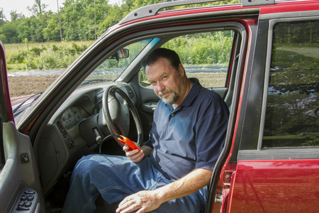 fault: Mechanic using a fault code scanner on a older truck. Stock Photo