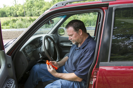 locked: A mechanic using a fault code scanner on a older truck