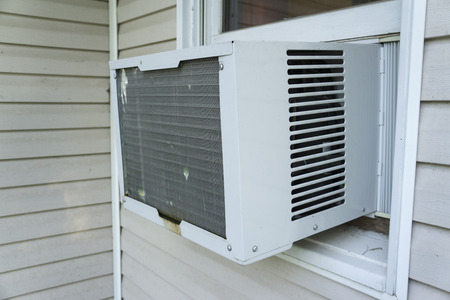 Window air conditioner keeping things cool .
