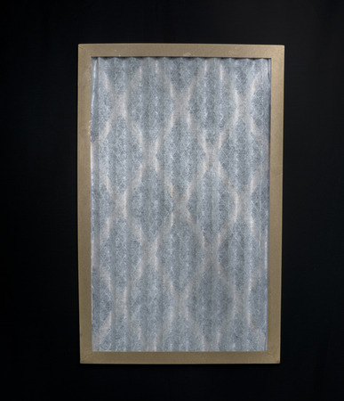 new filter: New premium furnace filter on black background. Stock Photo