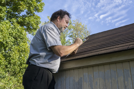 adjuster Insurance adjuster figuring hail damge done to insureds roof. & Adjuster Stock Photos u0026 Pictures. Royalty Free Adjuster Images And ... memphite.com