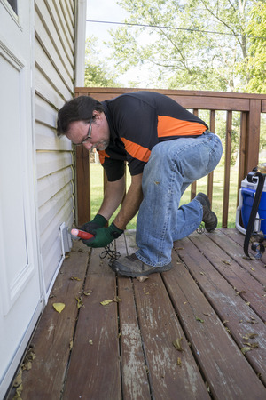 patio deck: Electrician checking outlet on outside patio deck. Stock Photo