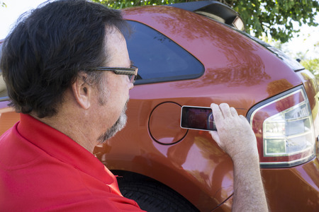 pics: Insurance adjuster taking pics of dames done to a vehicle.