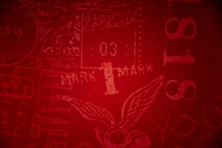 with stamp design on red backdrop