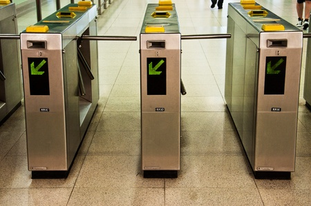 train ticket: ticket validation machines in a row Editorial