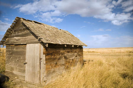 Old wooden shed on the prairies. photo