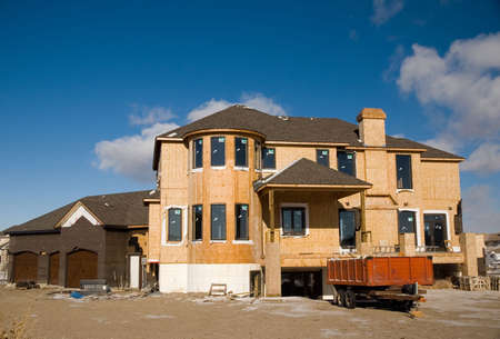 worksite: A two luxury home under construction - with a triple gargage. Stock Photo