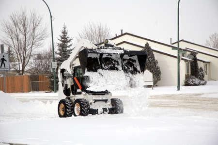 Bobcat removing snow.