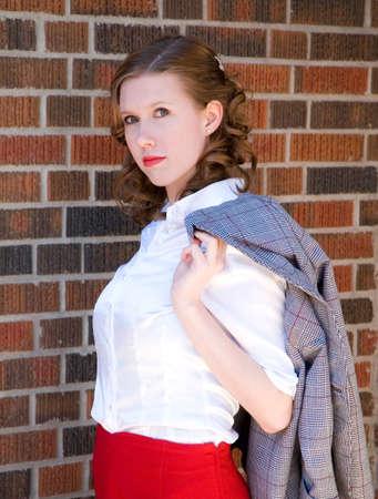 hottie: 50s hottie with coat over her shoulder. Stock Photo