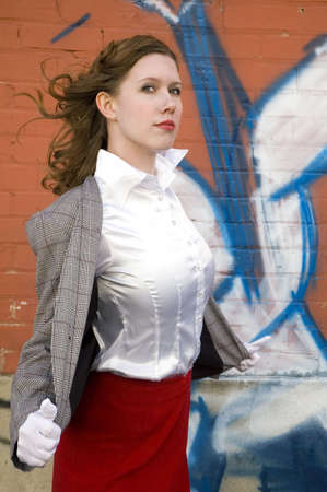 50s style picture of a cute brunette infront of graffiti. photo