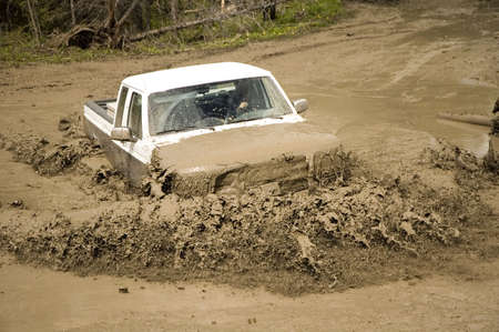 4x4 action through a huge mud hole. Stock Photo