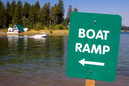 green boat: Green boat ramp sign, for a lake.