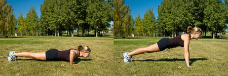 Woman in black shorts doing push ups in the park. Stock Photo