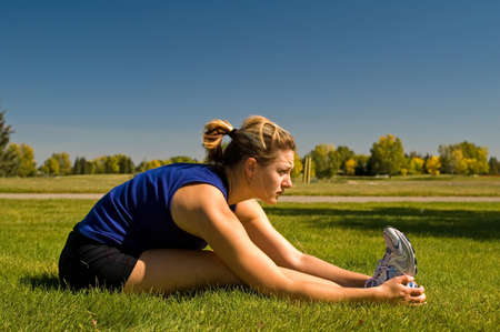 Woman stretching her hamstrings.