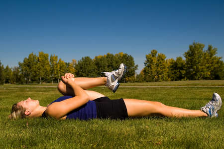 hamstrings: Young woman in a prone hamstring stretch.