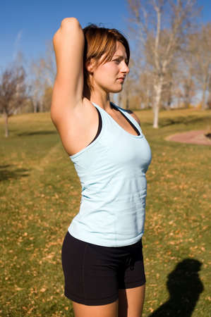 tricep: Young woman stretching her tricep.