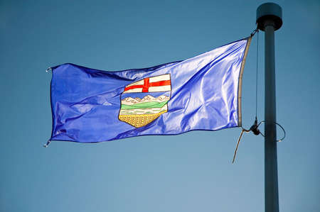 Albertas provincial flag flying from a flag pole.
