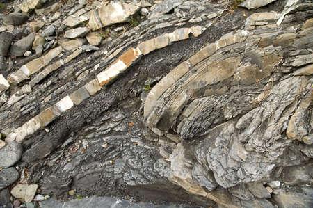 Folded bedrock of mudstone and shale.