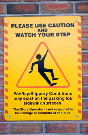Warning sign for slippery conditions in a parking lot. Stock fotó