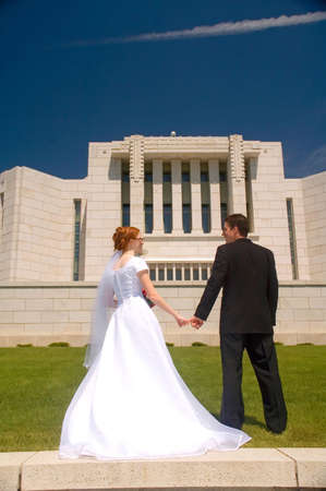 Newly wed couple standing outside the Cardston Temple.