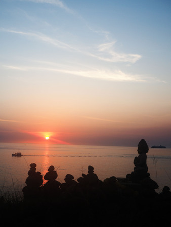 curio: Buddha statue in the sunset sky Stock Photo