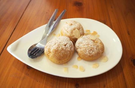 sweetmeats: Choux cream with almond Stock Photo