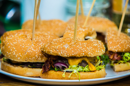 Sandwich hamburger with juicy burgers, cheese and mix of vegetables
