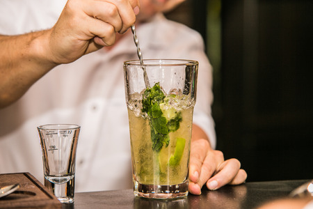 Bartender preparing a cocktail drink at the bar Stock Photo